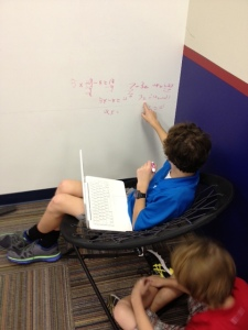 Working a problem on the idea wall in the Learning Studio